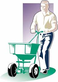 Graphic of man using a rotary spreader